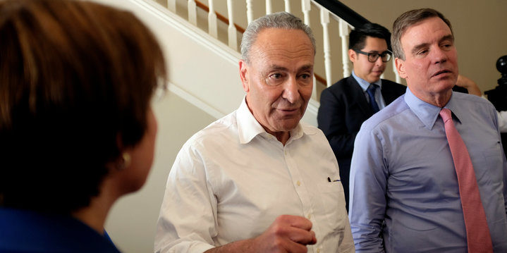 """Senate Minority Leader Chuck Schumer (D-NY) (C) huddles with Sen. Mark Warner (D-VA), and Sen. Amy Klobuchar (D-MN) (L) before unveiling the Democratic party's """"A Better Deal"""" for working Americans in Berryville, Virginia, U.S., July 24, 2017. REUTERS/James Lawler Duggan"""