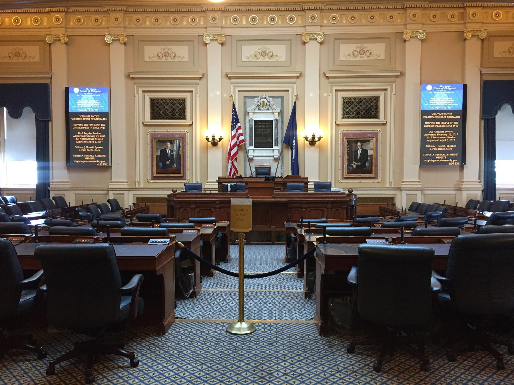 An image showing an empty Virginia House of Delegates Chamber in 2017.